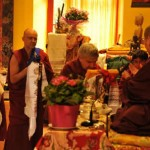 Ven. Lama Namgyal, Ven. roara Vestre, and Ven. Lama Gyurme offering the body, speech, and mind mandala to H.E. Jetsun Khandro Rinpoche, Vajradharling, France 2012.
