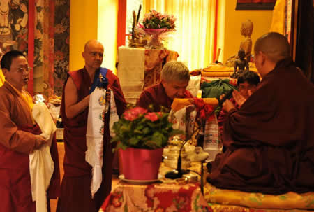 Ven. Lama Namgyal, Ven. Roar Vestre, and Ven. Lama Gyurme offering the body, speech, and mind mandala to H.E. Jetsun Khandro Rinpoche, Vajradharling, France 2012.