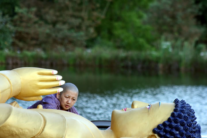 Jetsün Khandro Rinpoche with the Lotus Garden Buddha statue just before its installation on August 19 2010.