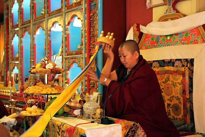Jetsün Khandro Rinpoche receives a mandala offering.