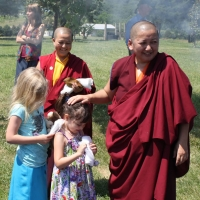 Jetsün Khandro Rinpoche visits with youngsters Lily Baker and Sofina Davis at Lotus Garden.