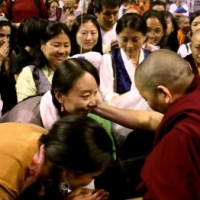 Jetsün Khandro Rinpoche surrounded by audience members after her teaching on bodhicatta. Kalachakra empowerments with His Holiness the Dalai Lama. August 2011, Verizon Center, Washington DC
