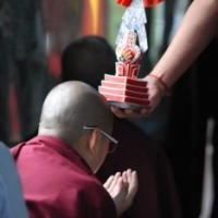 Jetsün Khandro Rinpoche receives a torma blessing during the Rinchen Terdzö empowerments at Mindrolling Monastery, 2008-09
