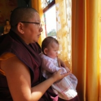 Jetsün Khandro Rinpoche and Jetsün Gautami Thrinley Choedron watching the Tse Chu ceremony at Mindrolling in March 2013.