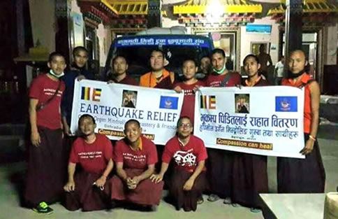 Monks gather for a photo before departing to the earthquake area.