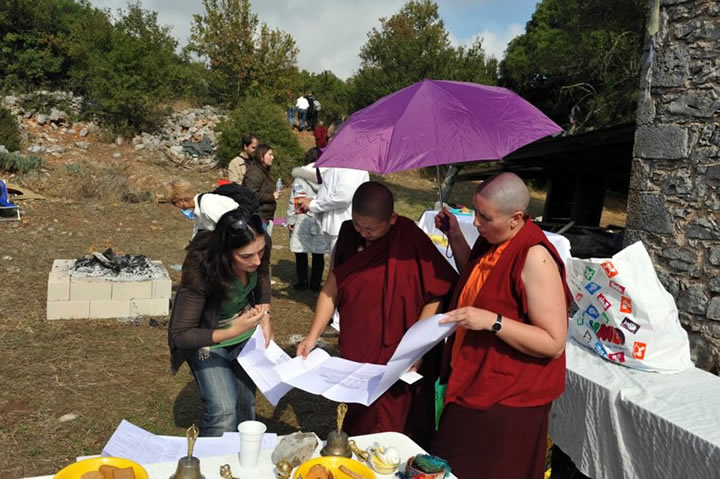 Jetsün Khandro Rinpoche reviewing architectural plans for the new Rigdzin Gatsal centre