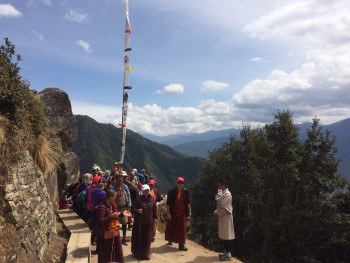 Rinpoche and group descending from Taktsang.