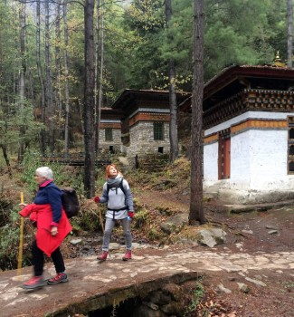 Hikers passing 3 small temples.