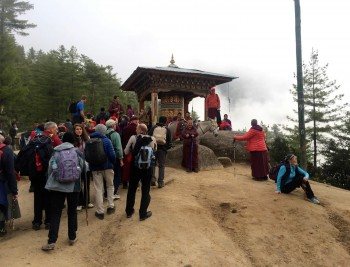 Rinpoche and hikers resting at the half-way point to Taktsang.