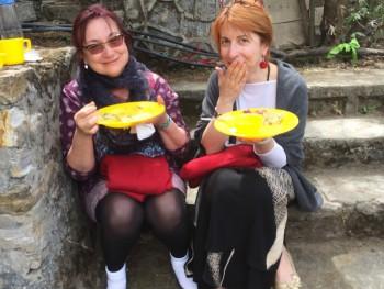 Mila Ridout and Seda Rafilovich enjoy lunch outside the lhakhang.