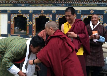 During a tea given by Lama Kunga la's family, khatags are offered to Jetsün Khandro Rinpoche while Kunga la and his father look on.