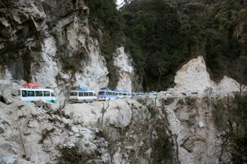 Caravan of pilgrimage vehicles.