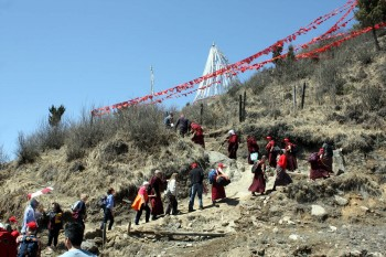Jetsün Khandro Rinpoche leads the climb to Chödrak Monastery built at the site of Longchenpa's retreat cave.