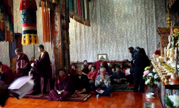 Offering prayers in the shrine room at Tharpaling Monastery.