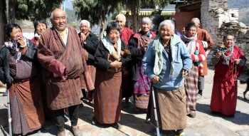 Townspeople arrive to request blessings from Jetsün Khandro Rinpoche.