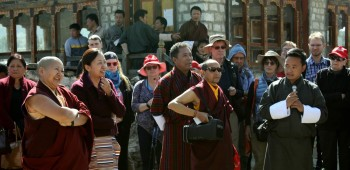 One of the guides shares a story as Rinpoche, Jetsunla and Tenpa Choepel look on..