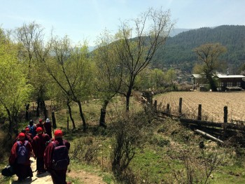 Jetsün Khandro Rinpoche leads the way from Tamshing Lhakhang to Kenchogsum Lhakhang.