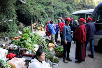 Passengers are delighted to stretch their legs and shop at an all-organic roadside market.
