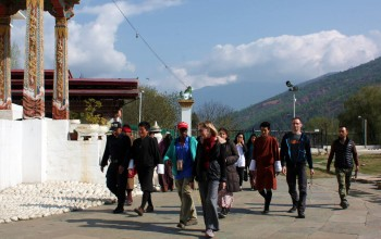 Group members join the locals in circumambulating the chorten.
