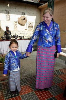 Jetsün Rinpoche and Lisa Cyrus showing off their traditional<em> Bhutanese garments for women called </em>kira.