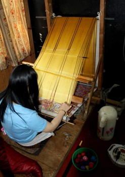 Weaver at her loom in the textile centre.