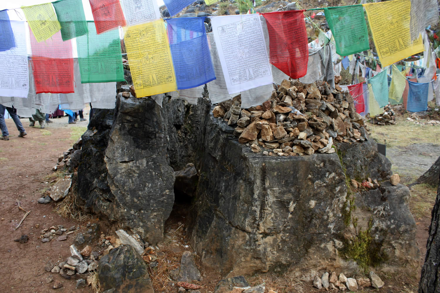 The rock removed from the cave entrance and split by Guru Rinpoche.