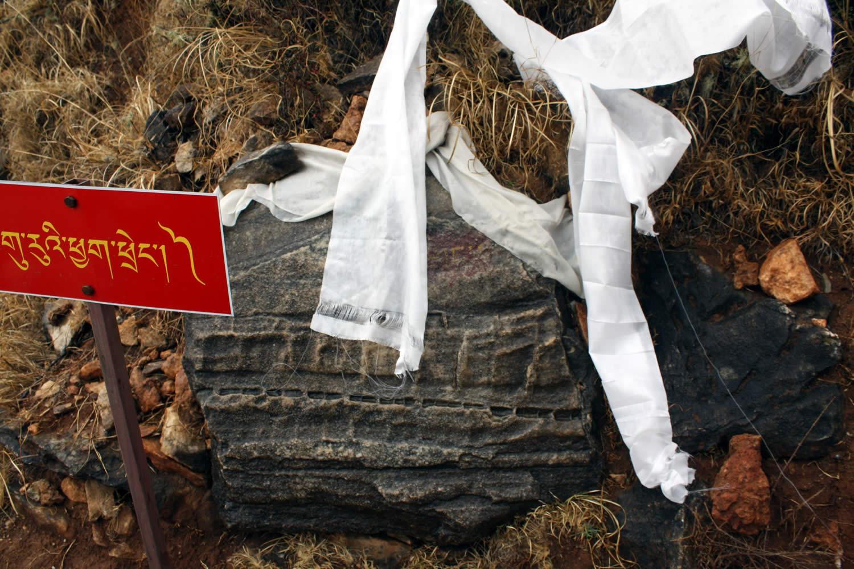 A sacred rock bearing the imprint of Guru Rinpoche's mala.
